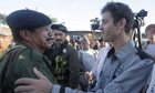 French journalist Romeo Langlois embraces a Farc commander during his release in San Isidro Colombia