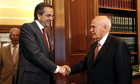 Greek president Karolos Papoulias welcomes leader of the New Democracy party Antonis Samaras