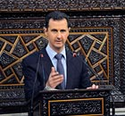Bashar al-Assad delivers a speech to Syria's parliament