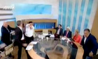 Greek neo-Nazi MP punches female communist on television – video