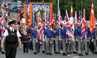 Three Ligoniel Lodges make their way past the Nationalist Ardoyne shops in north Belfast