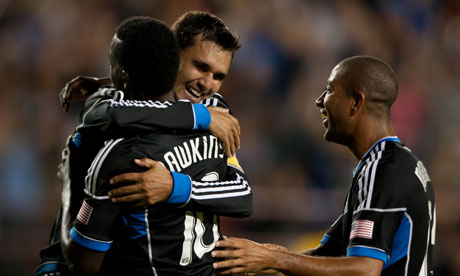 San Jose Earthquakes' Chris Wondolowski celebrates with teammate Simon Dawkins