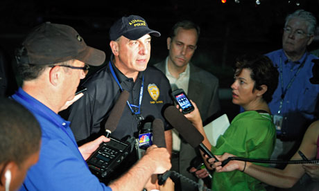 Aurora police chief Daniel Oates talks to the media
