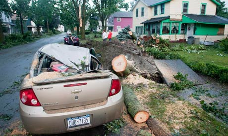 A crushed automobile is seen the morning after the town was hit by a tornado in Elmira, New York