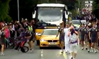 Olympic torch security tackles boy on bicycle