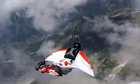 A wingsuit base jumper in Chamonix
