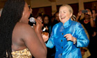US secretary of state Hillary Clinton and South African jazz singer Judith Sephuma dance