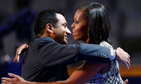Michelle Obama hugs Obama administration official Kal Penn