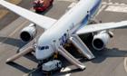 Dreamliner with evacuation shoots deployed and emergency response vehicles