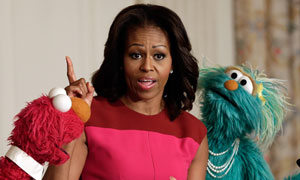 Michelle Obama and Sesame Street puppets promote healthy eating Michelle Obama teams up with Elmo and Rosita at the White House to promote her Let's Move! initiative for health.