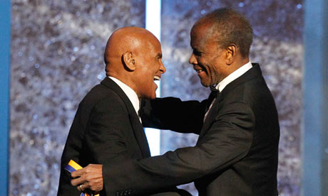 Harry Belafonte receives his award from Sidney Poitier