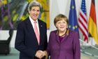 John Kerry and Angela Merkel in Berlin
