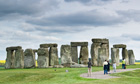 People on walkway at Stonehenge, stone circle in the landscape