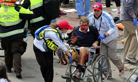 Boston marathon explosions: hunt begins for perpetrators - live updates