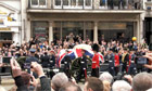 Margaret Thatcher's coffin passes a crowd at Aldwych