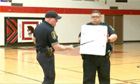 Police showing bullet-proof white boards at US school