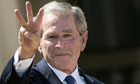 Former US President George W. Bush makes W sign with fingers at opening of his library