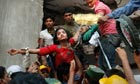 A Bangladeshi woman survivor is lifted out of the rubble near Dhaka