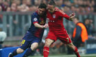 Lionel Messi of Barcelona takes on Franck Ribery of Bayern Munich during the UEFA Champions League S