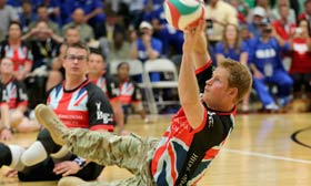 Prince Harry playing sit-down volleyball
