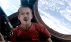 Commander Chris Hadfield performs David Bowie&#39;s &#39;Space Oddity&#39; in space - video