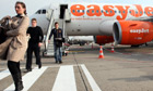 Passengers exit an EasyJet Plc airplane at Ferihegy airport
