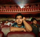 Ram Pratap Verma, a 32-year-old aspiring Bollywood film actor, watches a film at a cinema in Mumbai