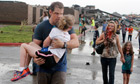 Teachers carry children away from school after tornado in Moore
