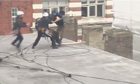 G8 protester on roof restrained by police in London