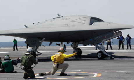 Drone lands aboard USS George HW Bush
