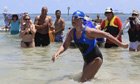 Diana Nyad walks to dry sand in Key West after completing her swim from Cuba
