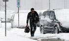 A traveler walks in snow in Chicago