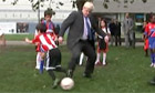 Boris Johnson trips child during football match
