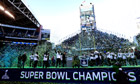 Seattle Seahawks players and coaches celebrate as confetti falls during a rally on Wednesday, Feb. 5
