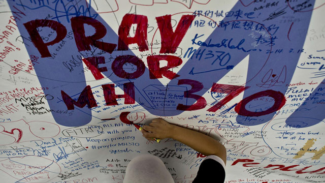 http://static.guim.co.uk/sys-images/Guardian/Pix/audio/video/2014/3/14/1394793565703/MH370-tributes-010.jpg