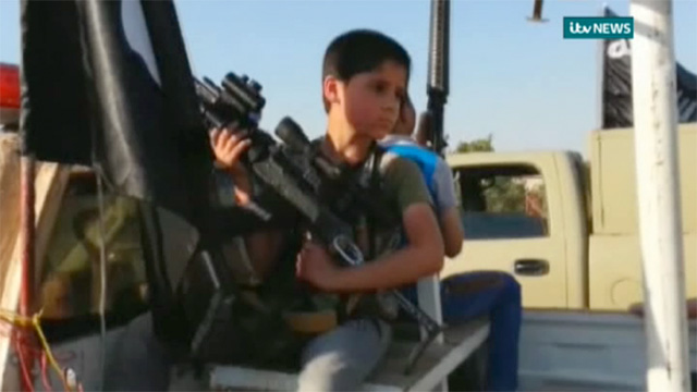 Iraq: gun-toting children paraded in Isis convoy - video ...