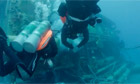 Divers approach the underwater lab