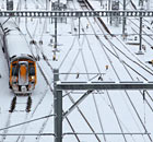 A train travels over snow covered tracks as it leaves Waverly Station in Edinburgh, Scotland