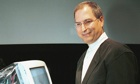 Apple Computer interim CEO and co-founder Steve Jobs poses next to new iMac after introduction 1999