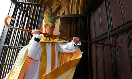 ustin Welby strikes three times on the cathedral door with his pastoral staff. Photograph: Chris Ison/PA