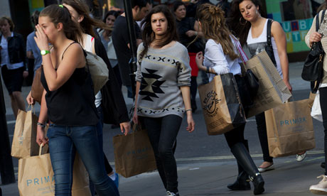 Shoppers carry their purchases as they w