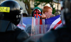 A Loyalist protester gestures to police in Belfast