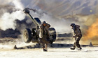 Nato soldiers firing heavy artillery at Taliban positions in Takhar province, Afghanistan