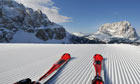 South Tyrol - skis point downhill on the slopes