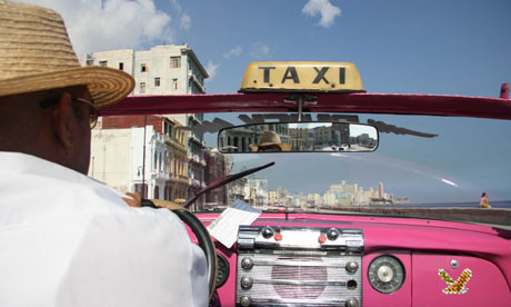 View from a Havana taxi (pink convertable)