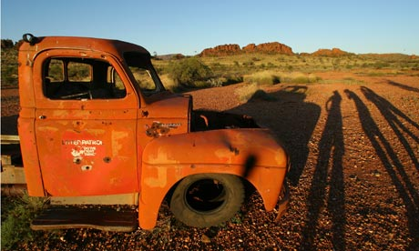 Sunset over an old vehicle near Glen Helen Gorge in Australia