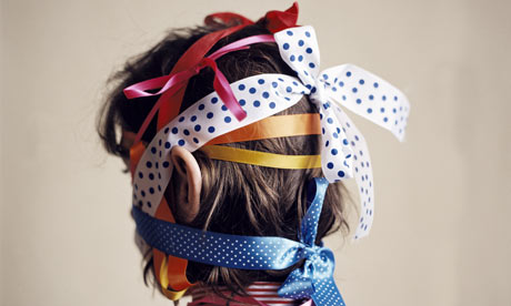http://static.guim.co.uk/sys-images/Guardian/Pix/commercial/2009/9/23/1253704416418/Woman-with-ribbons-tied-a-001.jpg
