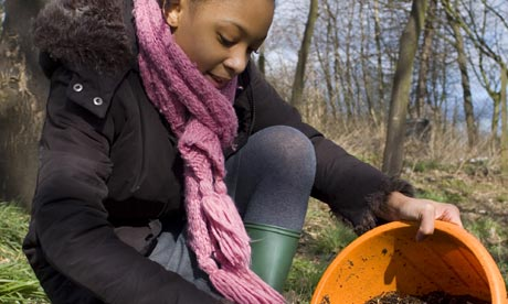 a child fills her pot with compost