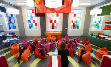 students sitting in a classroom on colorful oversized bean bag chairs