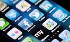 A close up of an Apple iPhone 4 screen showing the App Store and various social media apps